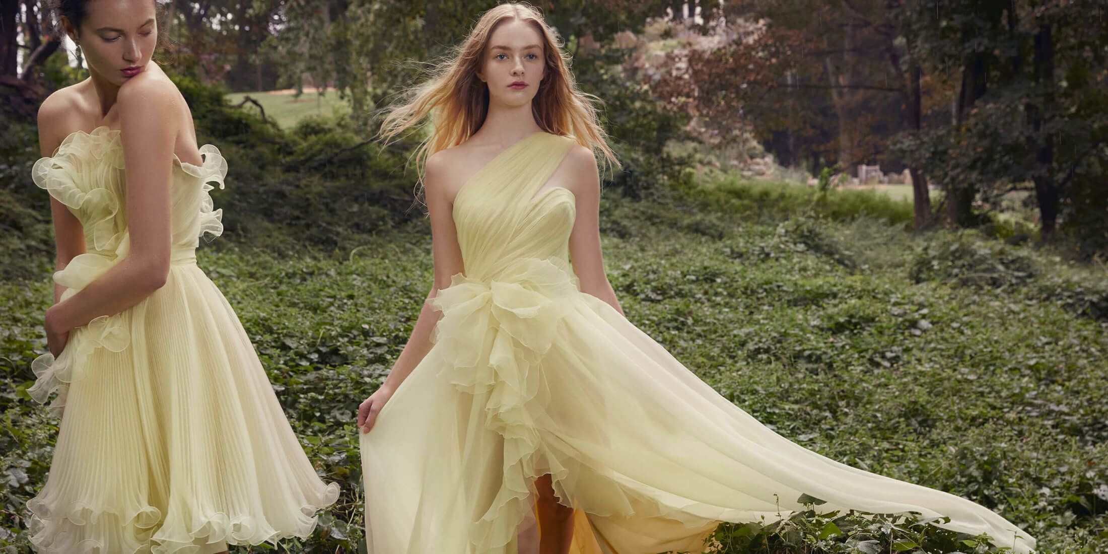 women wearing yellow marchesa dresses in green forest
