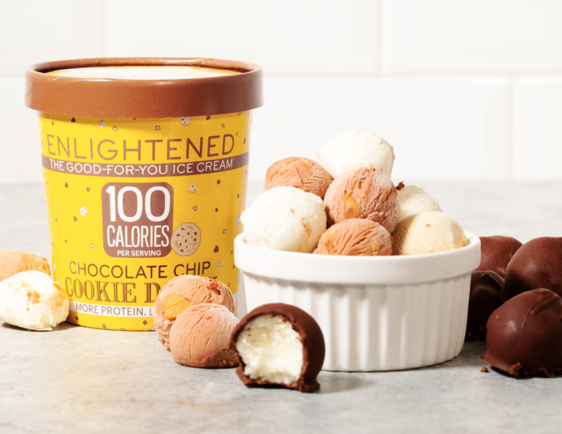 enlightened chocolate chip cookie dough pint beside cup of cookie dough balls