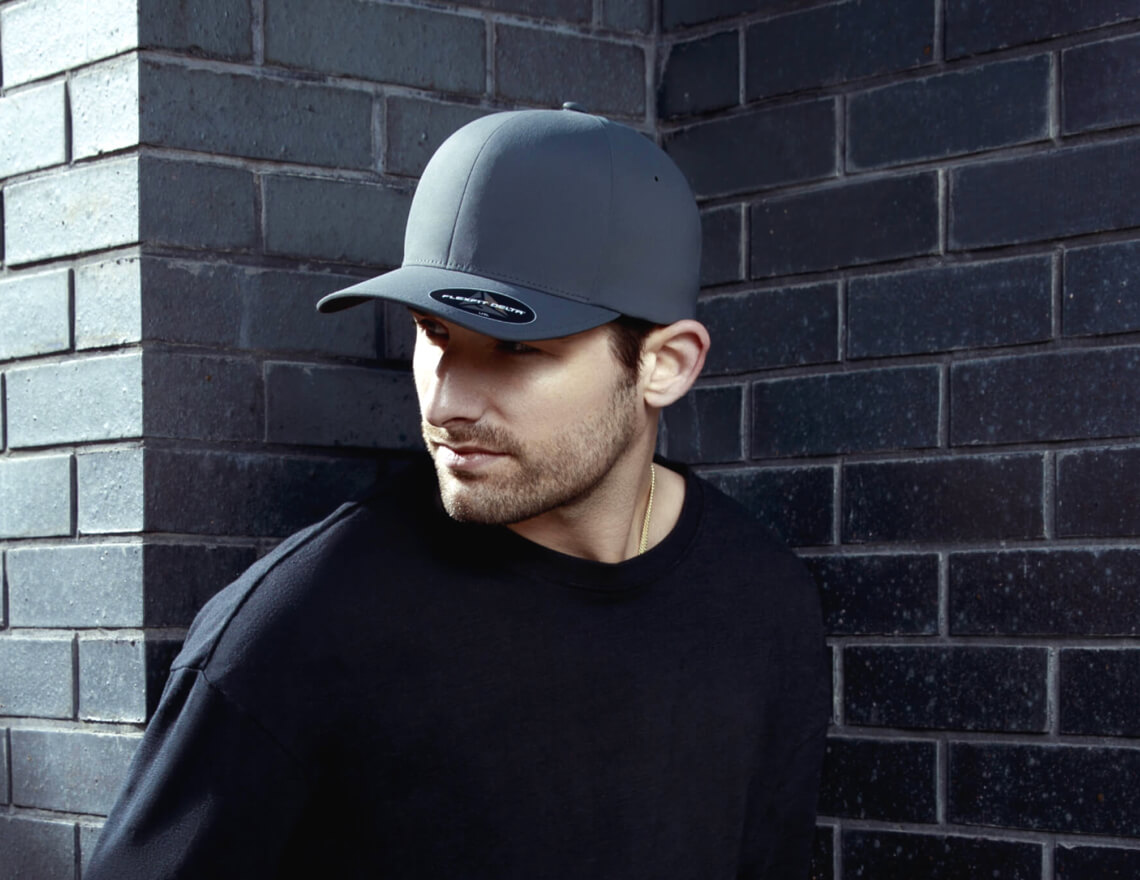 man wearing black flexfit cap