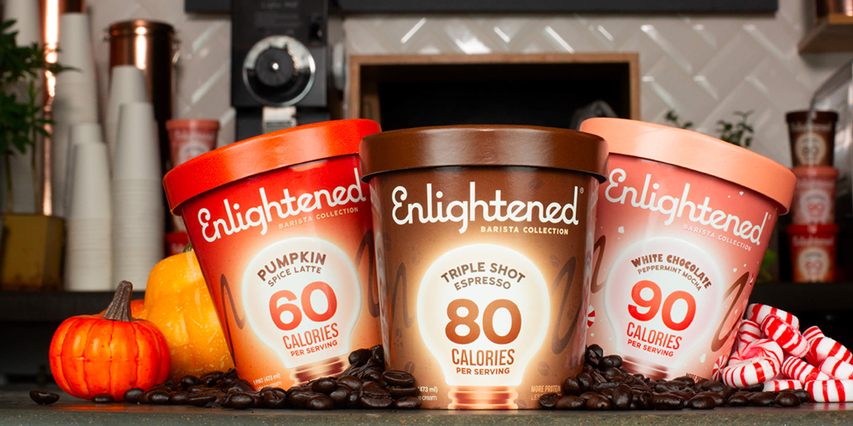 enlightened ice cream pints in coffee shop background