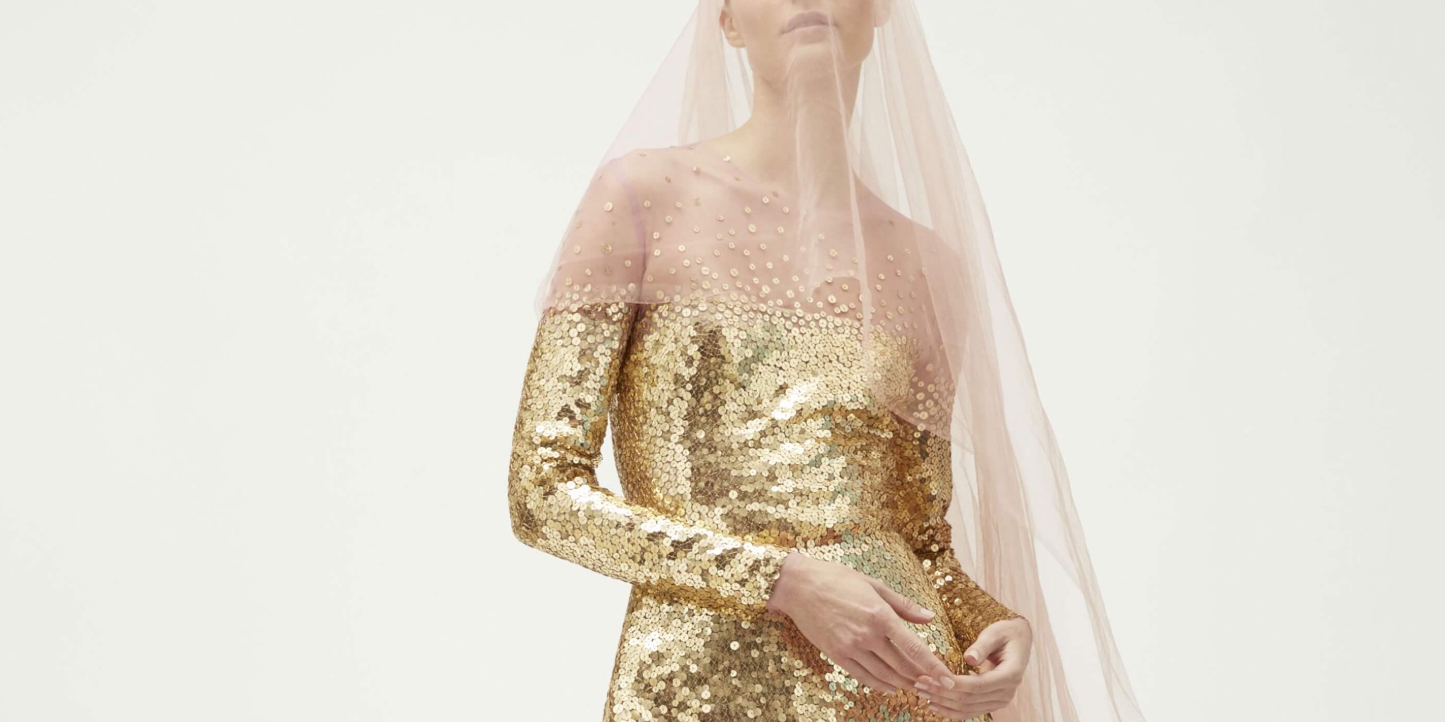 woman model wearing veil and gold reem acra dress