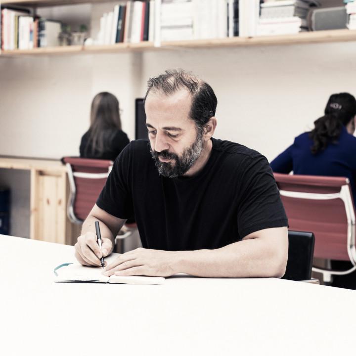 Michael Anastassiades sketching in his office
