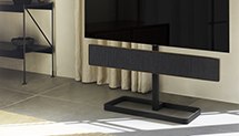 Beosound Stage floor stand accessory with Beosound Stage and a television