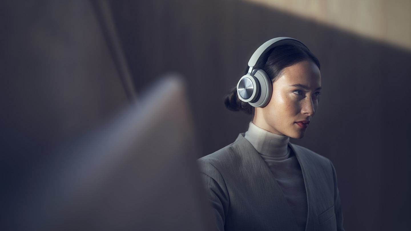 Woman wearing the Beoplay Portal to work
