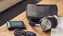 Berluti leather pouch with Beoplay H95 headphones