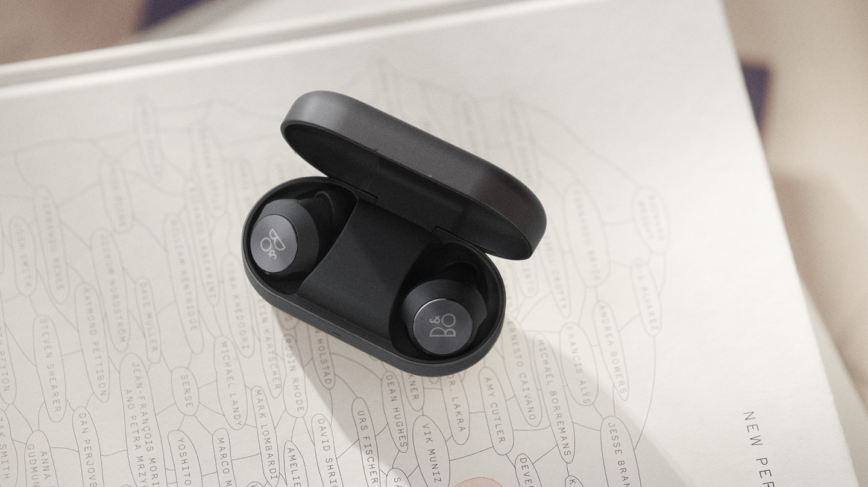 Beoplay EQ earphones in their charging case