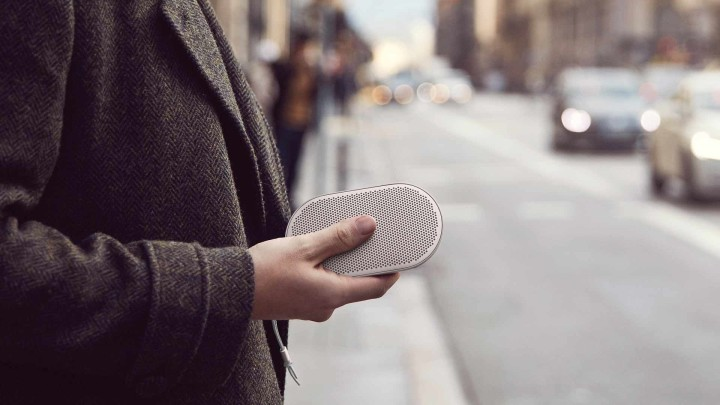 Beoplay P2 speaker in hand on the street
