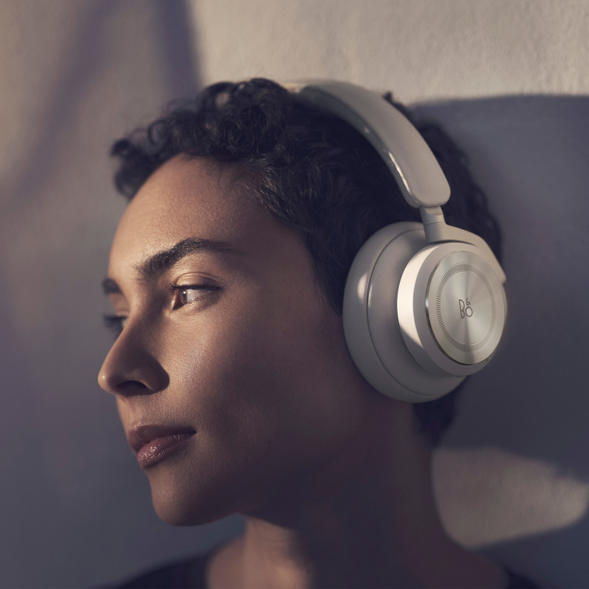 A woman wearing Beoplay HX Sand for a comfortable listening experience