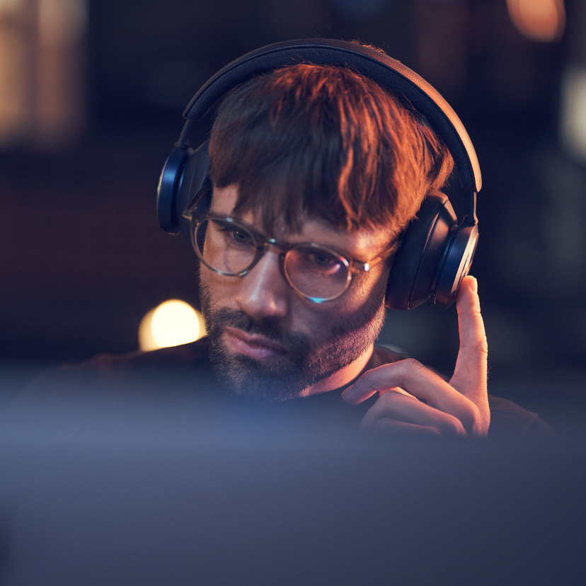 A man using the touch interface of Beoplay Portal, while enjoying of high-quality, immersive sound