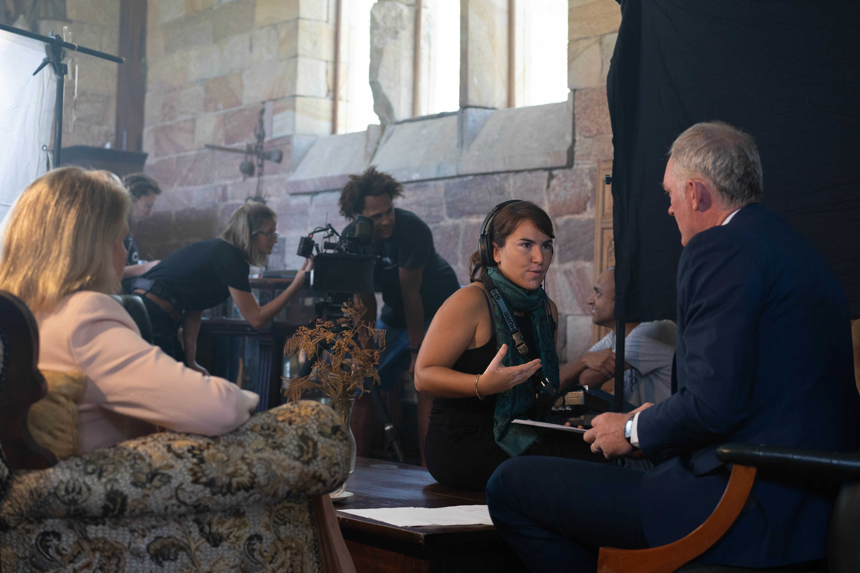 Alessia Francischiello on set discussing with actors
