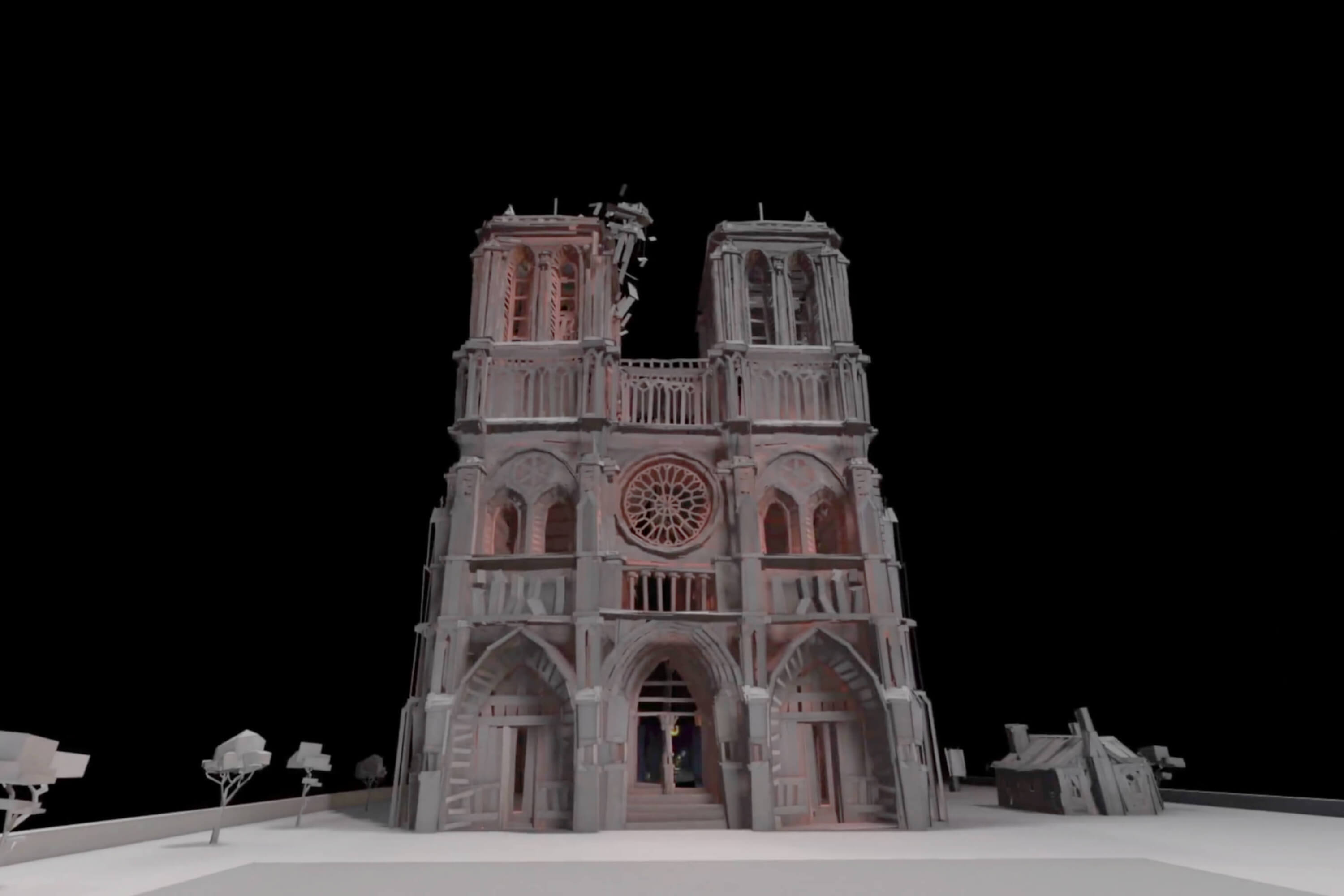 The computer-generated facade of the cathedral of Notre Dame stands in front of a black background.