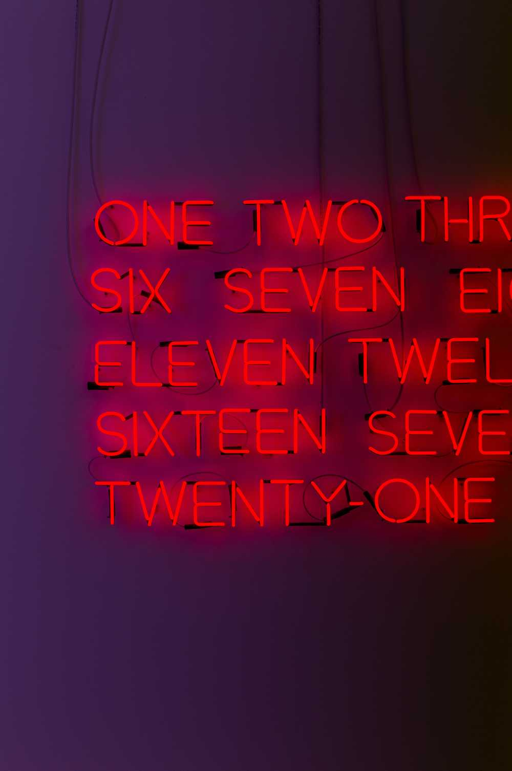 red neon numbers on a purple wall