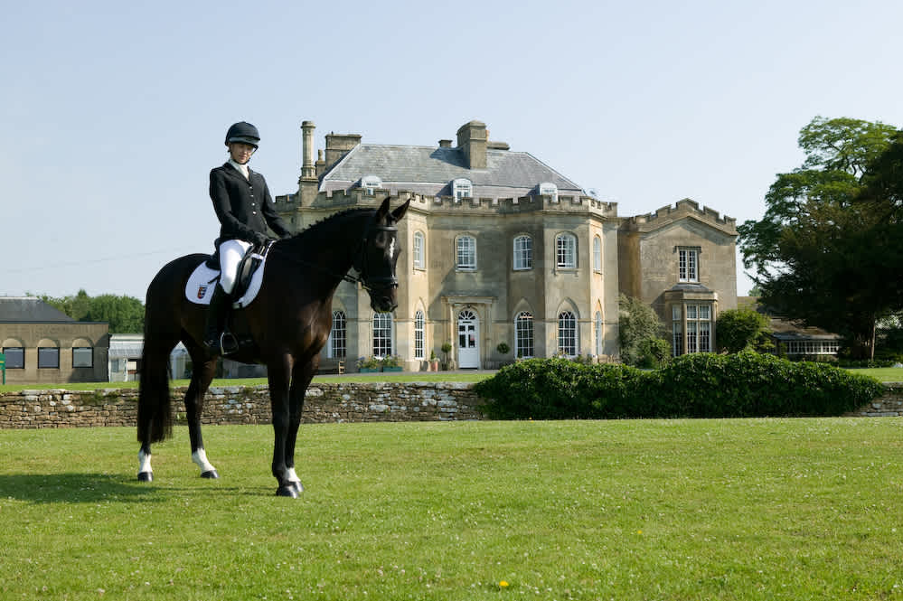 Stonar School - Horse and rider in front of the main building