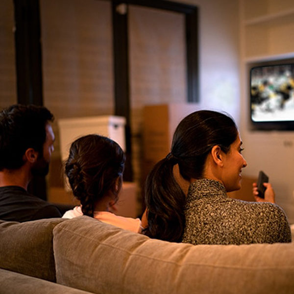 Family watching hockey game using Voice Remote