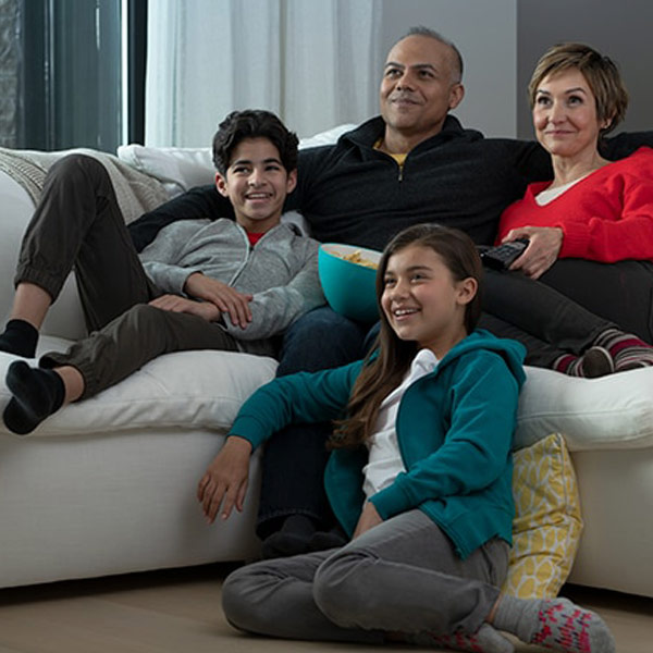 Family enjoying recorded game on Cloud PVR