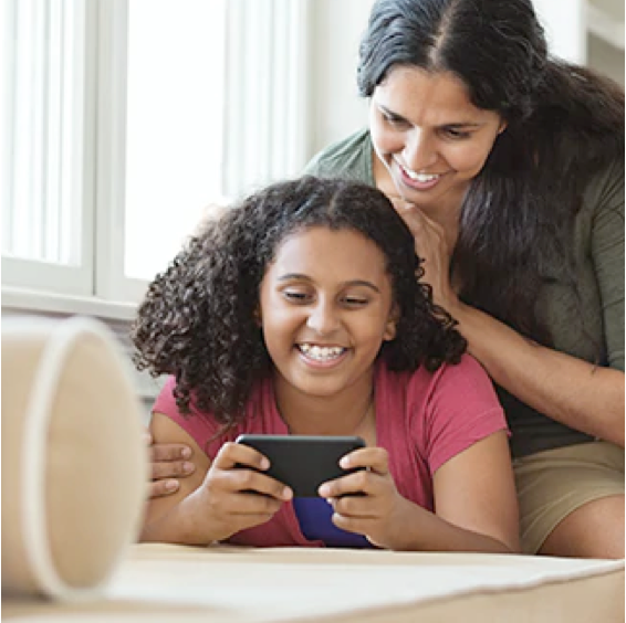 A mother and daughter enjoy Anyplace TV on a mobile device