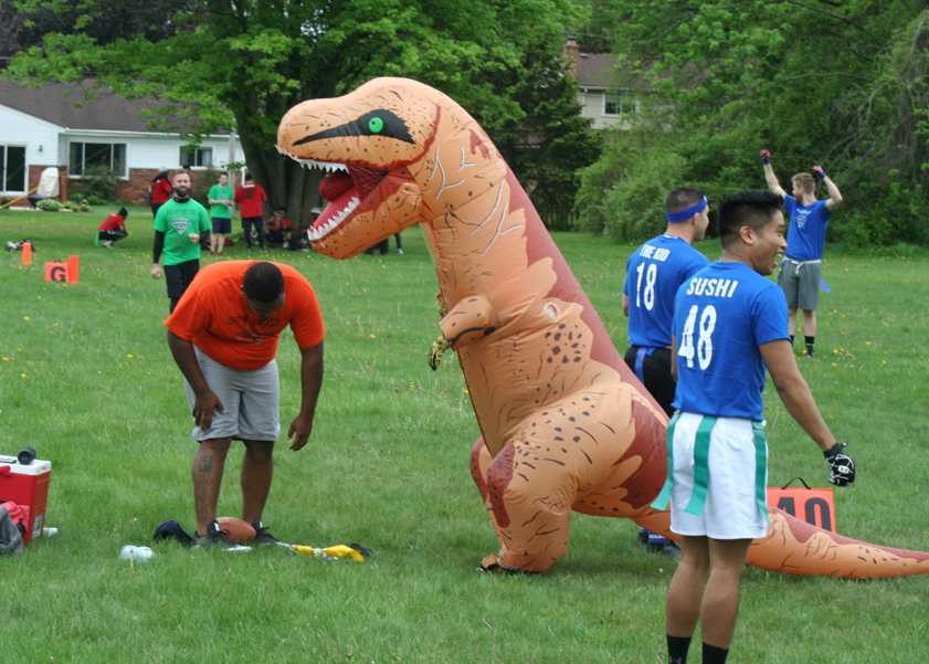Dinosaur mascot on field during warmups
