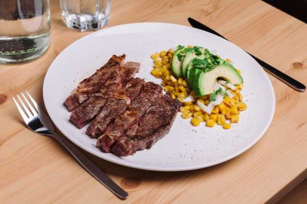 Steak with charred corn salad