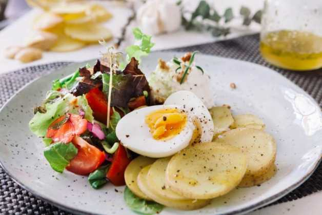 potatoes and egg with salad