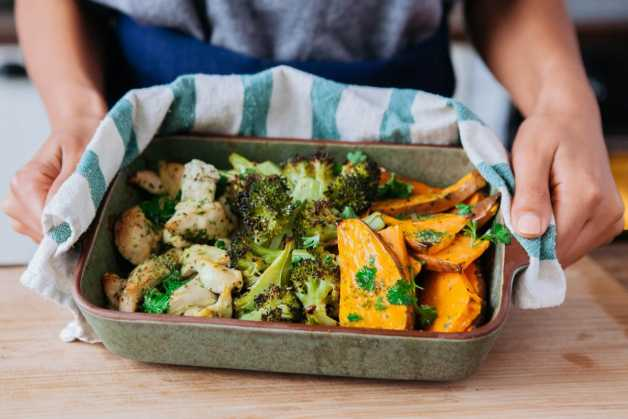 One pan roasted chicken sweet potato broccoli with hands