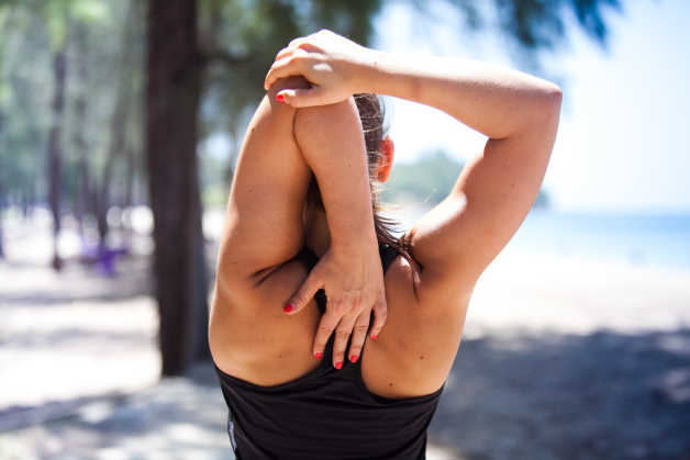 Shoulder stretch from behind, woman's back, female