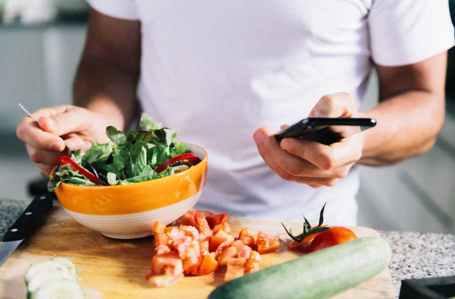 salad in a bowl and smartphone