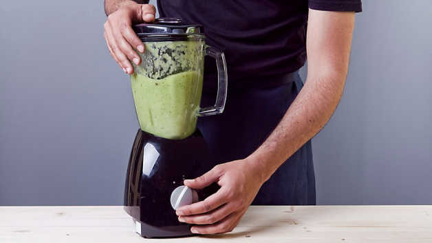 Green power smoothie in blender