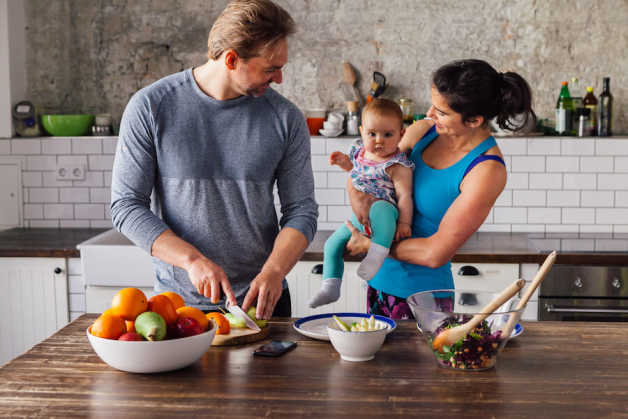 couple and baby in kitchen