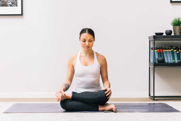 Seated pigeon pose yoga women indoors