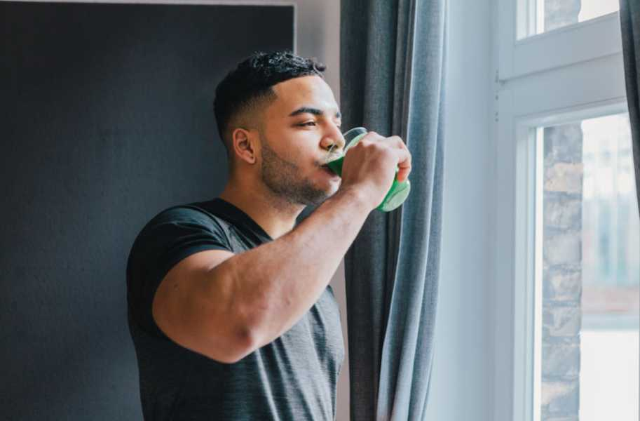 green-smoothie-male-drinking