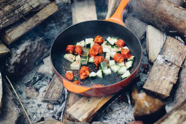 veggies in a cast iron pan on wood fire