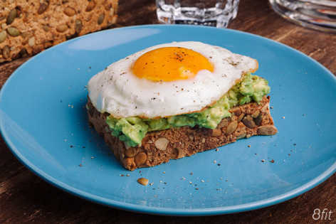 bread with avocado sunny side egg