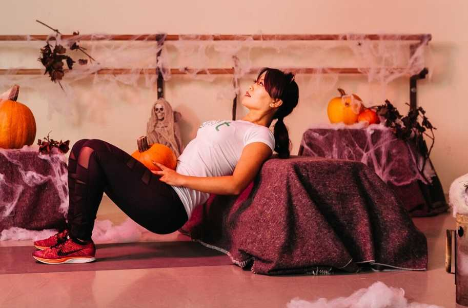 Marife with a pumpkin, halloween workout, woman