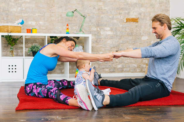 couple and baby working out