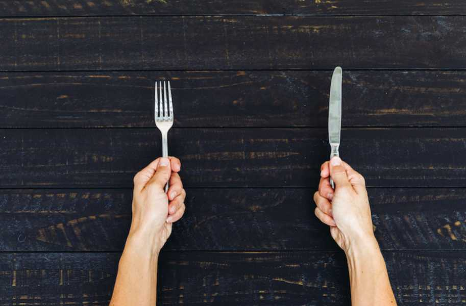 Fork and knife in hands