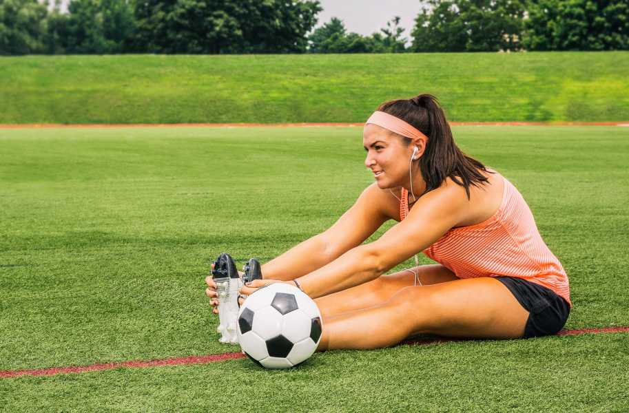 Girl stretching in soccer gear