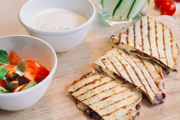 bean quesadilla with spicy salsa and yoghurt