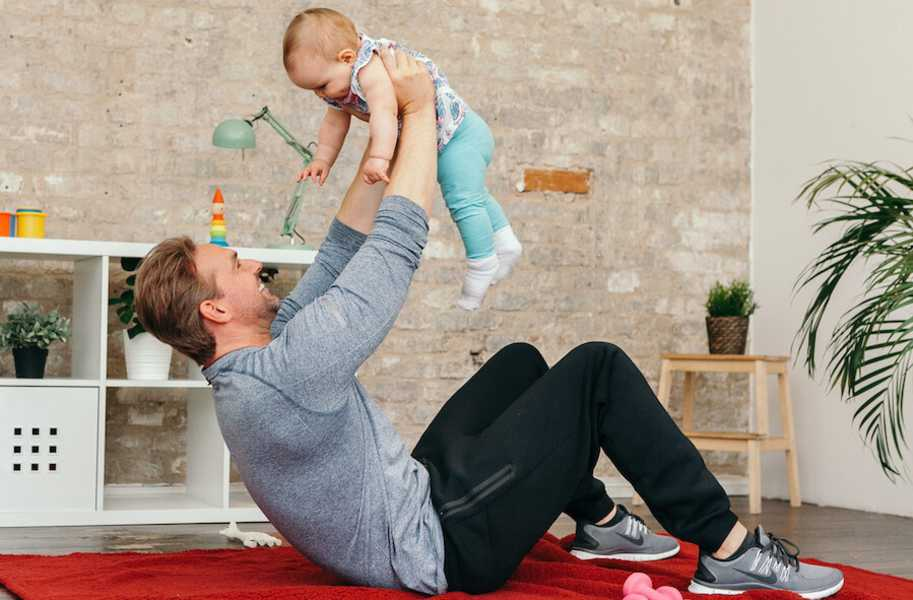 male exercise with baby
