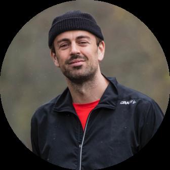 Man wearing black hat smiling