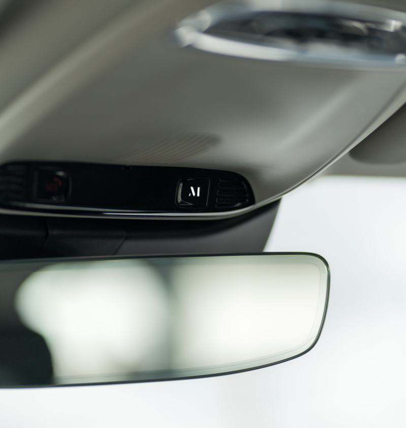 M Button above car rearview mirror