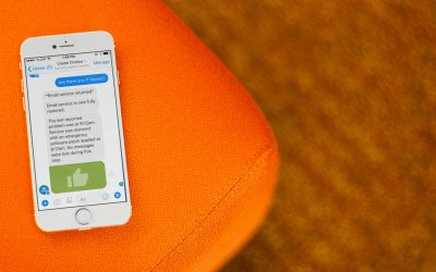 A phone sitting on a chair with an open chat with a chatbot