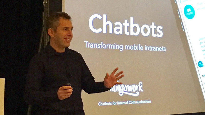 Chris McGrath speaking at a conference about chatbots