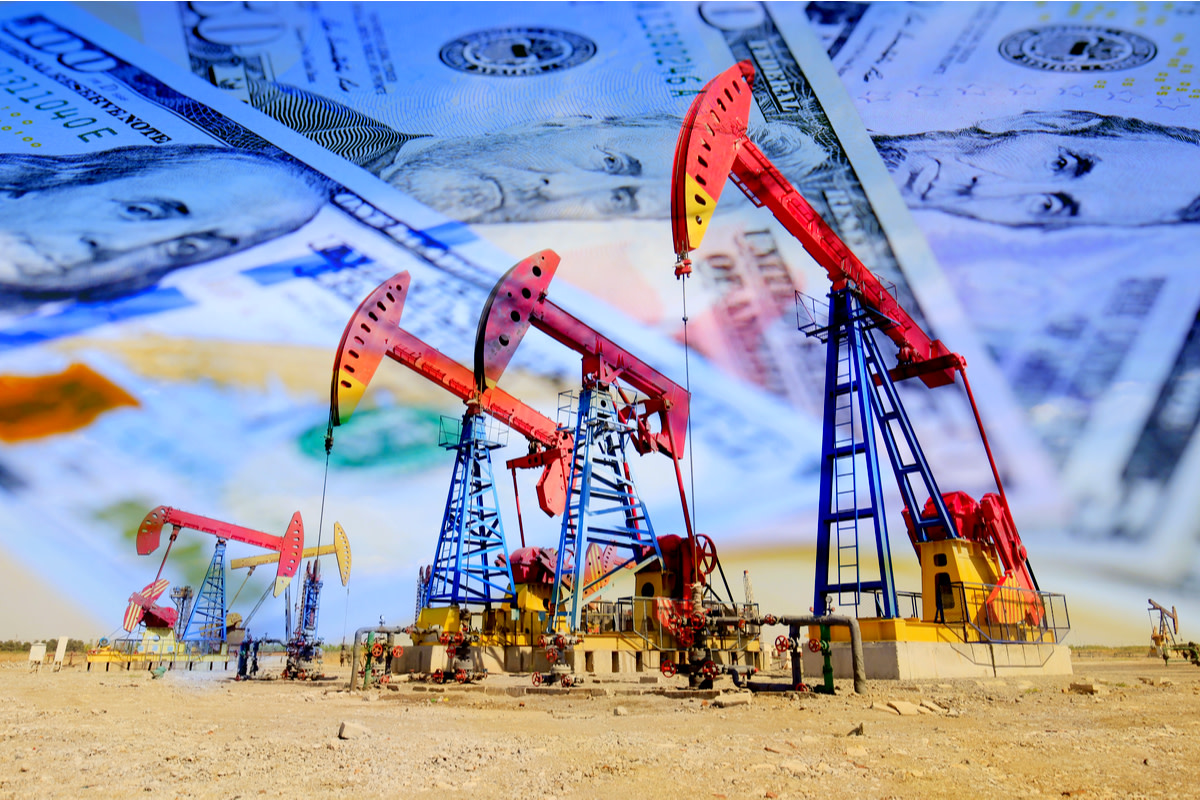 Oil pump on background of US dollar