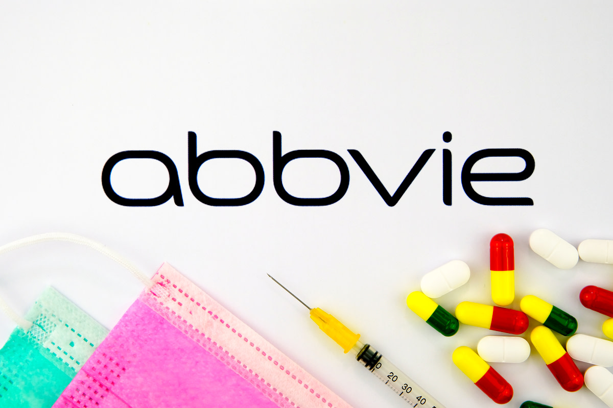 Abbvie biopharmaceutical company logo seen on the brochure with the viral masks