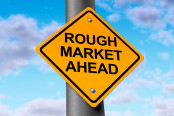 Rough stock market ahead road symbol representing the volatile swings and corrections