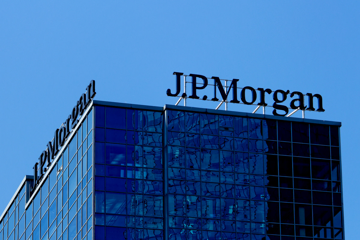 Sun shining on J.P. Morgan logotype on headquarters