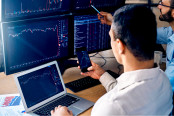 traders monitoring stocks data