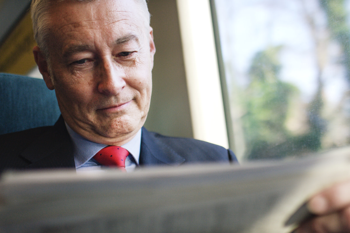 investor reading a newspaper