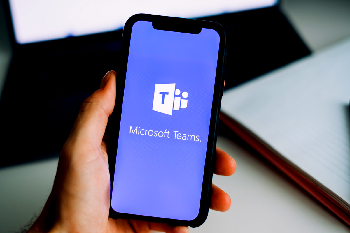 hand holding iPhone with Microsoft Teams