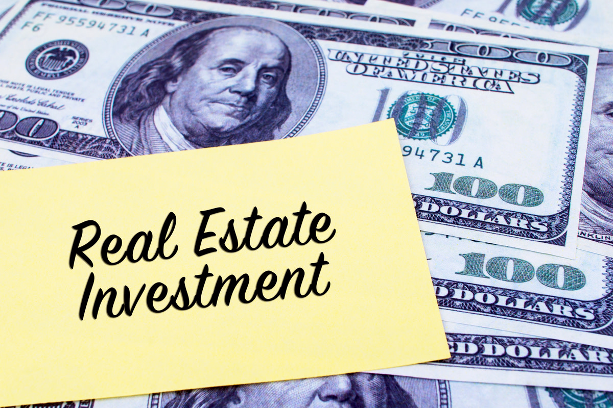 Real Estate Investment written on a yellow paper